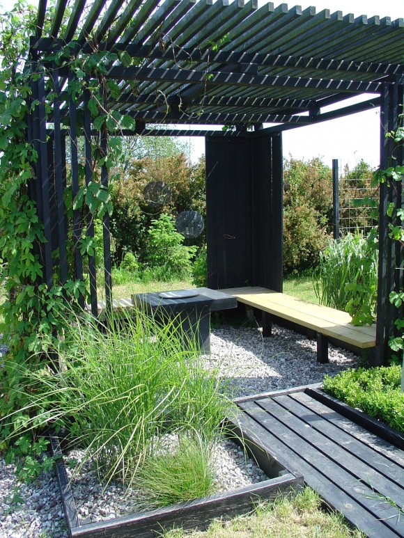 garden hut black slats patio cover from torvan via www.pithandvigor.com