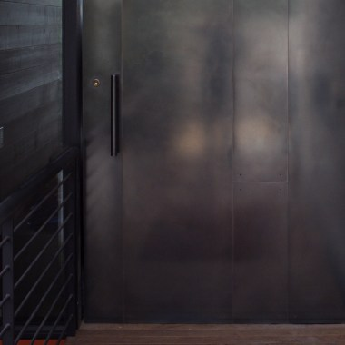 Blackened stainless steel door