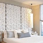 Elegante dormitorio con paneles decorativos en la cabecera