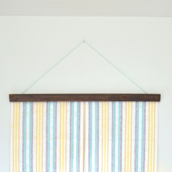 Easy DIY tapestry using a table runner -- Plaster & Disaster