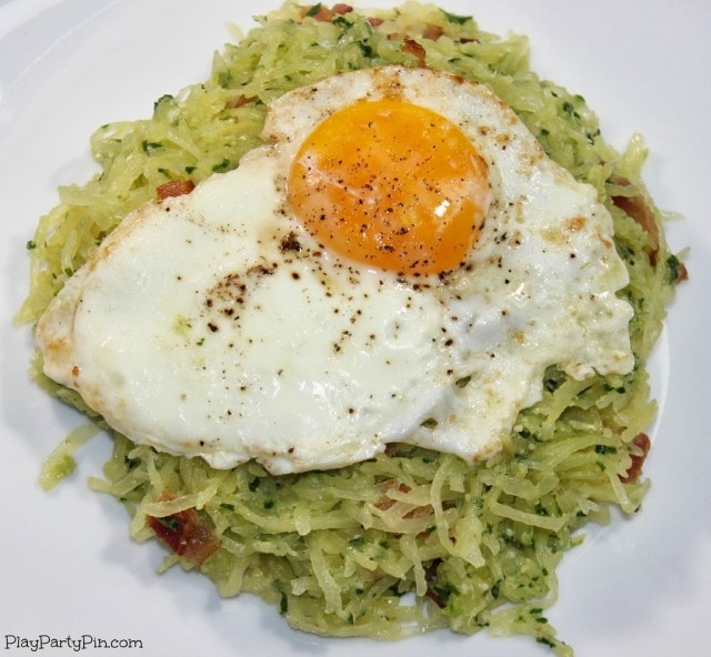 Spaghetti squash with pesto, bacon, and a fried egg from playpartypin.com #spaghettisquash #healthy #dinner #pasta