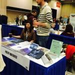 Volunteer Kristen Steenbeeke of Hugo House and Poetry Northwest Managing Editor Matthew Kelsey working the bookfair