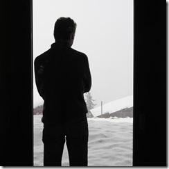 standing at the door