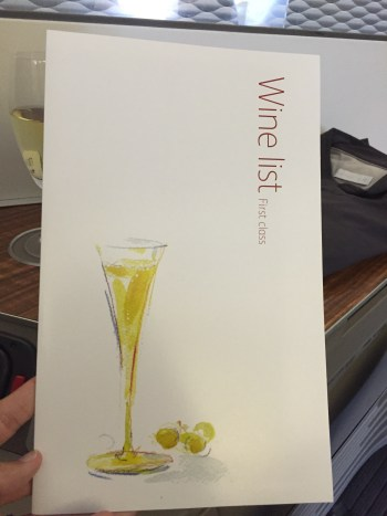 flight review cathay pacific first class review flight hkg lax krug menu