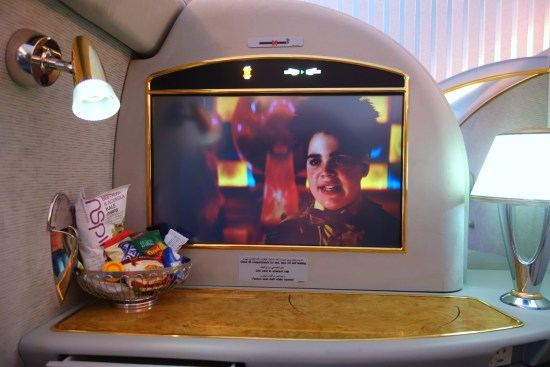 emirates first class business A380 bar shower champagne dom suite mxp dxb milan dubai EK