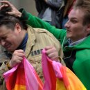Russian Orthodox church activist attacks a gay rights protester