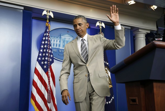 U.S. President Obama departs the White House Press Briefing Room after addressing reporters in Washington