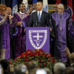 "U.S. President Barack Obama leads mourners in singing the song ""Amazing Grace"" as he delivers a eulogy in honor of the Reverend Clementa Pinckney during funeral services for Pinckney in Charleston, South Carolina June 26, 2015. Pinckney is one of nine victims of a mass shooting at the Emanuel African Methodist Episcopal Church.  REUTERS/Brian Snyder - RTX1HZJE"