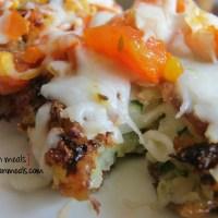 cheesy zucchini and potato cakes with fresh tomato sauce