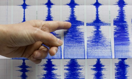 Taiwan's Central Weather Bureau official Lu Pei-ling points to seismograph readings of a 6.7 magnitude earthquake that shook Taiwan, Tuesday, Dec. 26, 2006, in Taipei, Taiwan. The quake, with a preliminary magnitude of between 6.7 and 7.2, was felt throughout Taiwan. It swayed buildings and knocked objects off the shelves in the capital, Taipei. No damage or injuries were immediately reported. (AP Photo)