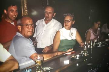 Young DON FELDOTT, far left in the red shirt, visits with patrons at The Lantern back in the 1960s.   Photo courtesy Teri Feldott
