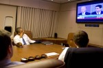 President Barack Obama watches the Vice Presidential debate aboard Air Force One with staff, en route to Joint Base Andrews, Maryland, from Florida, Oct. 11, 2012. (Official White House Photo by Pete Souza)