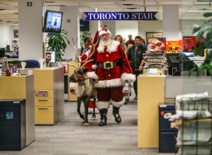 Santa and one of his Reindeer visits the Toronto Star