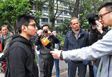 In this photo taken and released by a protester, a local university student, left, a supporter of the Southern Weekly, is interviewed by a foreign media before being taken away by plainclothes policemen outside the newspaper headquarters in Guangzhou, Guangdong province, China Thursday, Jan. 10, 2013. Police attempted Thursday to prevent more of protests outside the compound housing the Southern Weekly and its parent company, the Nanfang Media Group, in Guangzhou, a city long at the forefront of reforms. About 30 police officers guarded the area and ordered reporters and any loiterers to move away, saying there had been complaints about obstructing traffic. The influential weekly newspaper whose staff rebelled to protest heavy-handed censorship by China's government officials published as normal Thursday after a compromise that called for relaxing some intrusive controls but left lingering ill-will among some reporters and editors. (AP Photo)