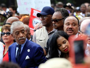 "Rev. Al Sharpton, left,  Martin Luther King, III, right, Jesse Jackson, in glasses, start the march at Lincoln Memorial during the rally to commemorate the 50th anniversary of the 1963 March on Washington at the Lincoln Memorial in Washington, Saturday, Aug. 24, 2013. Tens of thousands of people marched to the Martin Luther King Jr. Memorial and down the National Mall on Saturday, to commemorate King's famous """"I Have a Dream"" speech, made Aug. 28, 1963, during the March on Washington, and pledging that his dream includes equality for gays, Latinos, the poor and the disabled. (AP Photo/Jose Luis Magana)"