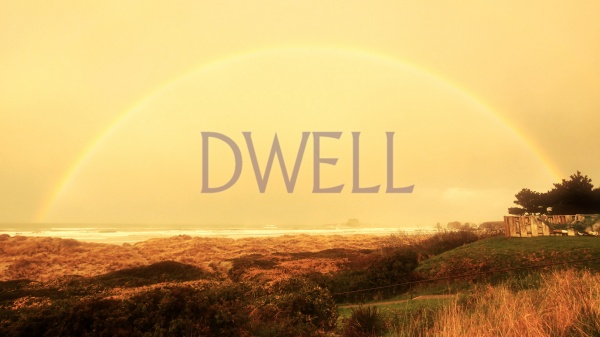 Dwell written underneath a beautiful rainbow