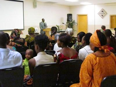 "Rev. Gisonga ""Aaron"" Ruvugwa leads worship at the Agape African Fellowship. (Photo provided)"