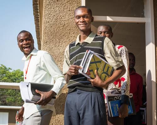 Lukas Nkhoma, Jonathan Thole and Watanga Ngoma leave the classroom at Justo Mwale University in Lusaka, Zambia. (Photo by Johanneke Kroesbergen)