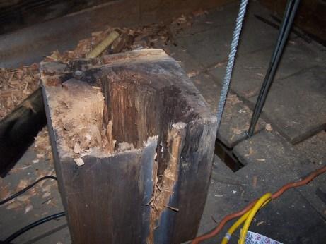 Rotten belfry post