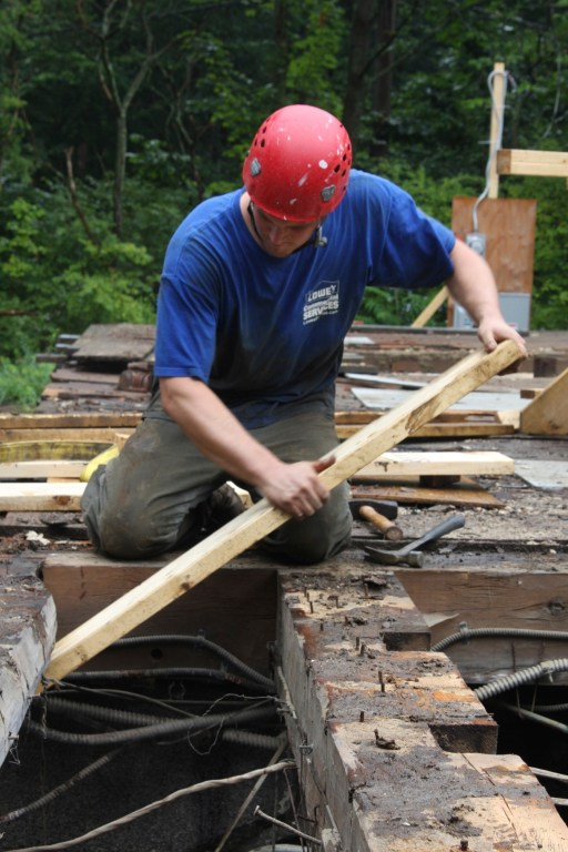 Dave, removing floor joists at the end of a long two days
