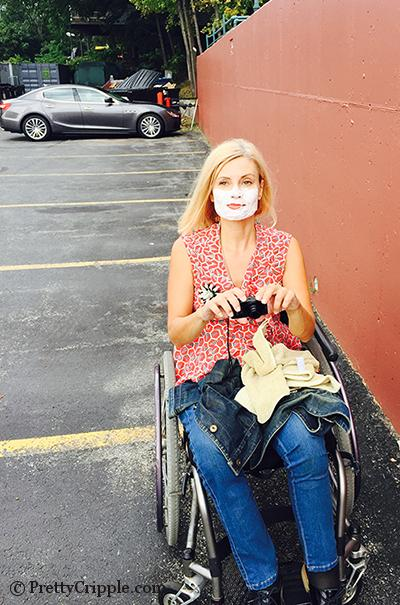 wheelchair blogger with shaving cream on her face in a parking lot.