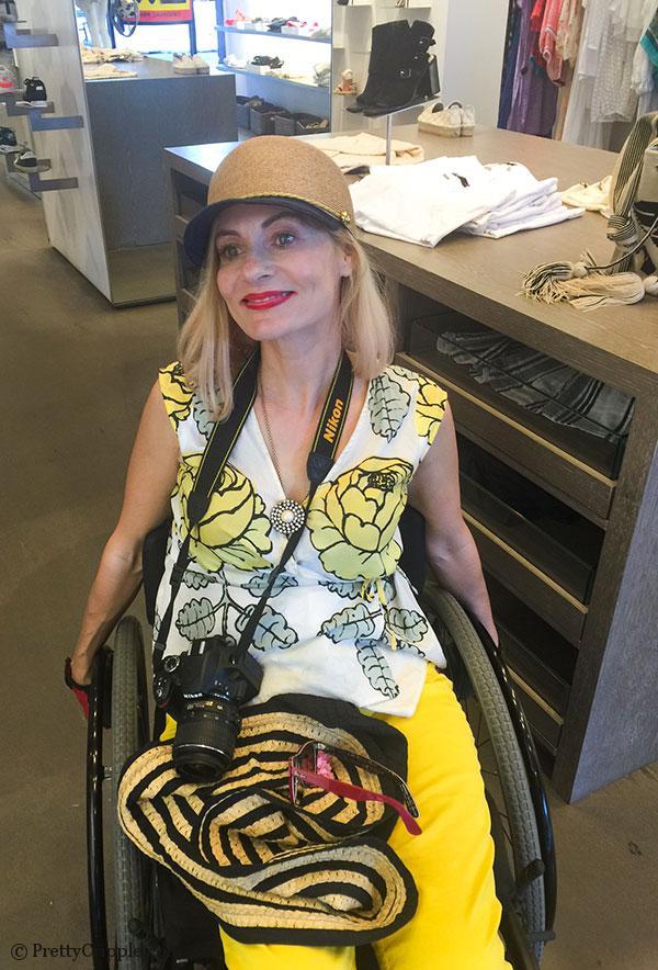 Wheelchair fashion blogger in ecstasy over a Eugenia Kim hat