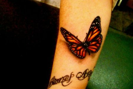 3d erfly tattoo on arm