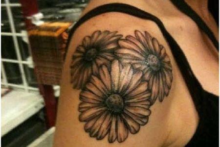 daisy tattoo on shoulder