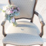wedding bouquet on chair with wedding ring