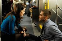Michelle Monoghan y Jake Jyllenhaal. Encuentro en un tren. Imagen de la película