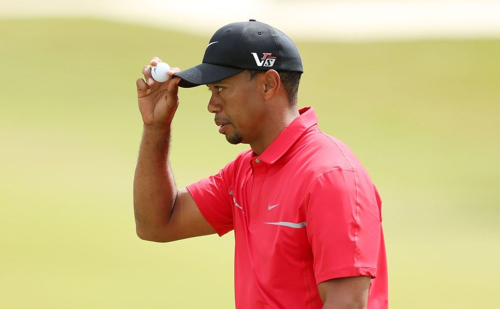 DORAL, FL - MARCH 10:  Tiger Woods celebrates his birdie putt on the second hole during the final round of the World Golf Championships-Cadillac Championship at the Trump Doral Golf Resort & Spa on March 10, 2013 in Doral, Florida.  (Photo by Warren Little/Getty Images)