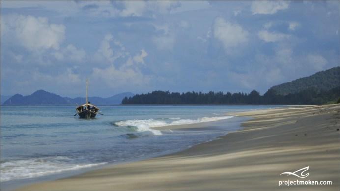 Kabang near empty beach wlogo