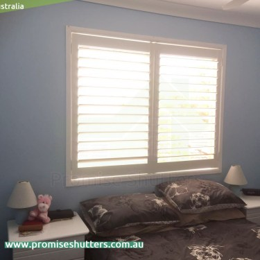 white vinyl shutters installed without added frame