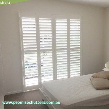 solid Vinyl window shutters installed in 1,2,4 panels
