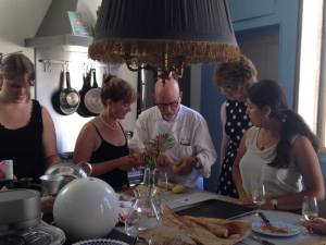 Photo courtesy of Jody Littleton/Parkland College (From left to right) Grace Dyrek, Jody Littleton, Chef Alex, Rebecca Grosser, and Nadya Cortes take a French cooking class during a study abroad trip supported by Parkland College.