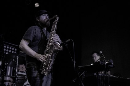 Photo by Sean Hersch | Sean Hersch Media  Saxophonist Nicholas Gerlach of Turbo Suit plays live at the Canopy Club in Champaign, Ill. on Thursday, March 4, 2015.