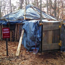 Photo by Michael Rubinkam | AP Photo  This March 23, 2015 photo shows the hut that Juniata College senior Dylan Miller built in the woods near campus in Huntingdon, Pa. For his senior research project on simple living, Miller decided to emulate Thoreau instead of just reading his work. So, deep in the woods about a half-hour's walk from campus, he built a hut out of fallen trees, leaves and a tarp - unheated, no plumbing - and has been living there since the beginning of the school year, studying by lantern and chasing away the occasional bear.
