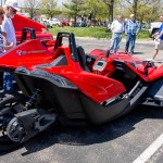 Photo by Scott Wells | The Prospectus  A couple admires the 2015 Polaris Slingshot.  Because it has 3 wheels, the federal government classifies the Slingshot as a motorcycle.