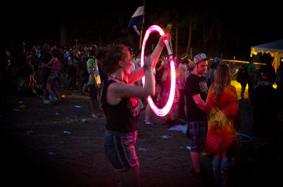 Photo by Billi Jo Hart | Prospectus News A Summer Camp Music Festival attendee plays with an LED hula-hoop in Three Sisters Park, Chillicothe, Ill. on Friday, May 22, 2015.