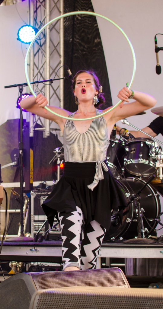 Photo by Billi Jo Hart | Prospectus News Sun Stereo performer Christine Janak hula-hoops during a set at Summer Camp Music Festival on Sunday, May 24, 2015.