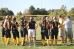 Photo by Ruben Aguilar | The Prospectus  The softball players gather around their coach, Chuck Clutts, after winning their game against Danville on Tuesday, Sept. 15, 2015. The cobras played well and were able to defeat Danville with a final score of 7-3.