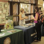 Photo by Zonghui Li   The Prospectus A Parkland student visits Millikin University's booth during the Parkland College Transfer Fair in the College Center on Wednesday, Sept. 16, 2015.