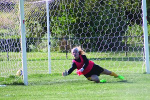Photo by Ruben Aguilar | The Prospectus Goal keeper Jenna Ashley dives to keep the ball from entering the Cobras' goal at the home soccer game against Southwestern Illinois College on Thursday, Oct. 1, 2015. The Cobras took another victory with a final score of 3-0.
