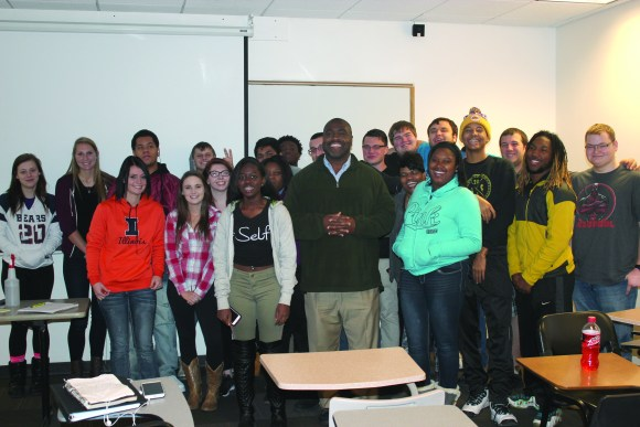 Photo by Scott Barnes | The Prospectus Students in Dr. Willie Fowler's classroom stand for a picture during their POS 122 class at Parkland College. Classrooms like these show the growing evidence of diversity on campus.