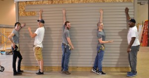 Photo by Lindsay Cox |  From right to left: Zachary Jackson, Caleb Lyons, Joey Adams, Zach LaPayne, and Jesse Boone, all parkland college students, work together on building a shed during their construction class.