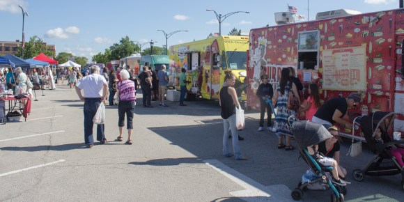 Photo by Derian Silva | Food trucks at Market at the Square are visited by patrons on Saturday, June 24, Urbana, Ill.