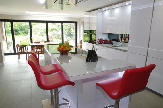 Polar White Kitchen with stools by Perresini