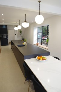 Matte Black kitchen with Dekton Domoos worktop / Calcutta gold quartz tabletop and Bora Basic glass ceramic induction cooktop and appliances by Siemens
