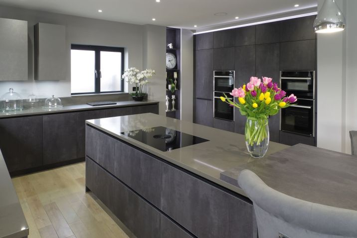 BORA Pure Induction cooktop on kitchen Island / Neff Slide & Hide single ovens, steam oven and microwave either side of secret utility room door