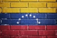 23153340 - venezuela flag on the brick wall